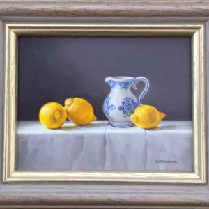 A Blue and White Jug with Lemons